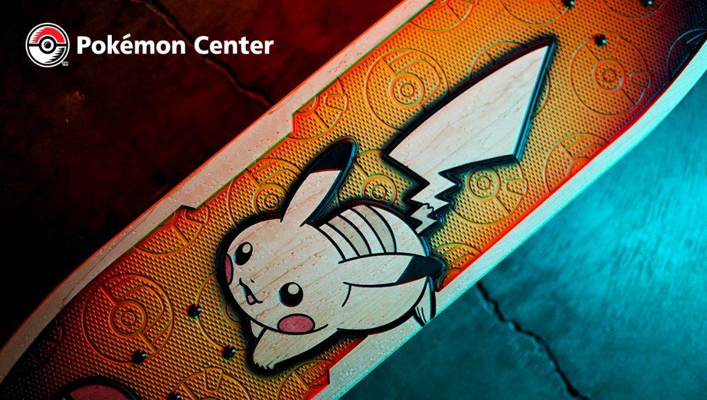 Pokemon-themed skateboard, with Pikachu on it.