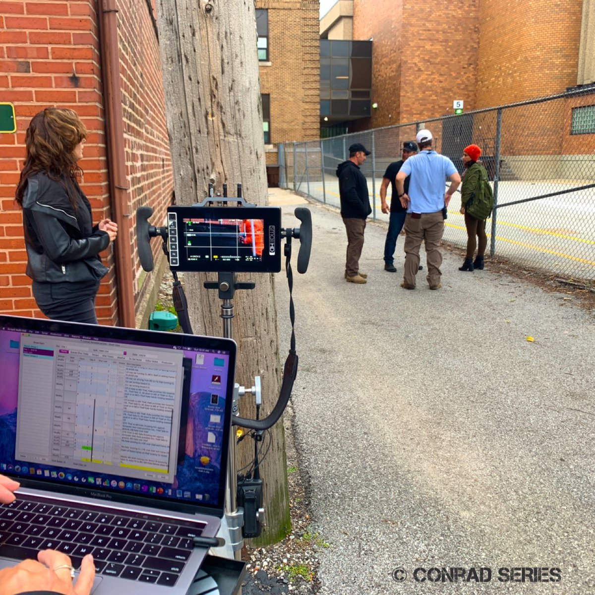 A pleasant brick building-lined street can quickly turn into a crime scene in the Conrad universe.  #conrad #conradseries #newseries #newshow #newtvshow #bingewatch #copdrama #dramaseries #womeninfilm #artistswithautism #chicagoproduction #bts #behindthescenes