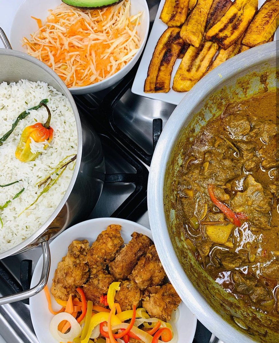 There's nothing like it!🤤 A good Caribbean meal with all the sides - curry goat, coconut rice, fried chicken, plantain, coleslaw and avocado.   #currygoat #currygoattutorial #eatingthecaribbean #caribbeanculture #food #foodie #blackfoodie #repost #windrushbay