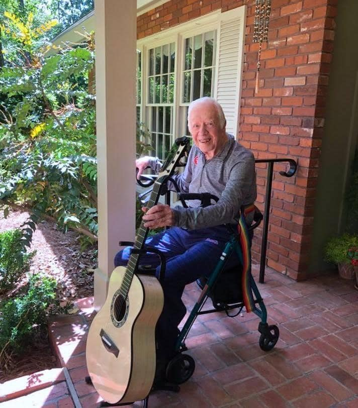 Replying to @georgeegirl: Jimmy Carter with a guitar he had made from a tree he planted.  Let  that sink in.