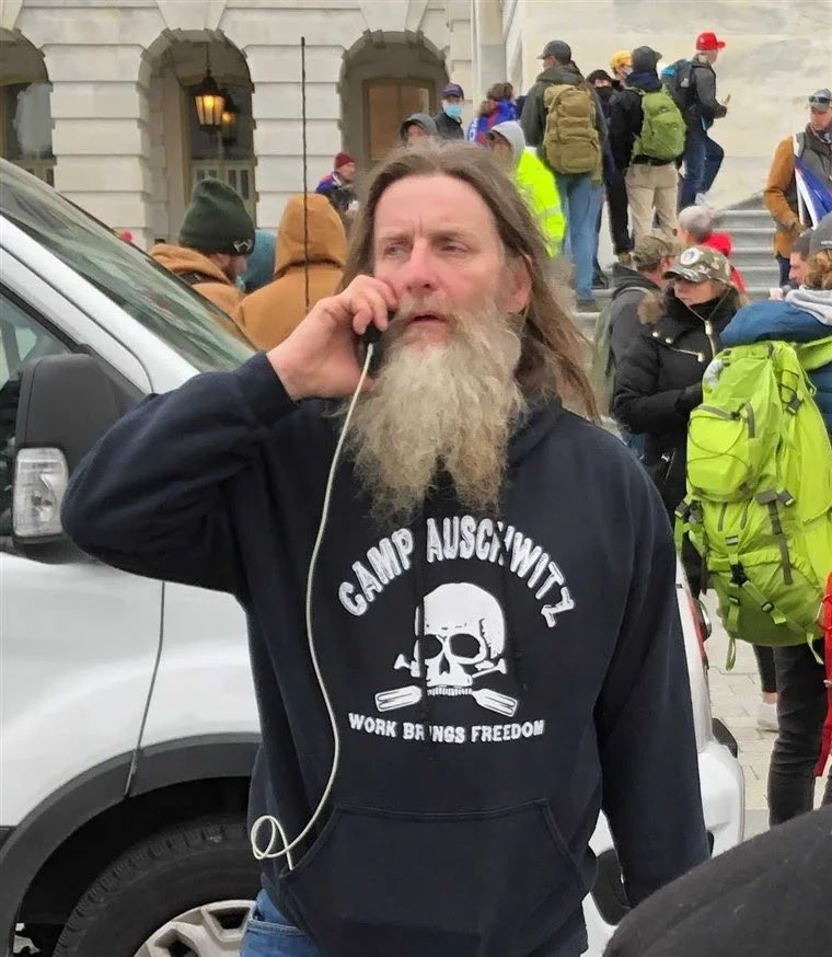 """They got this guy today.  I can't s top thinking about this sweatshirt and all the people around him who don't even give it a second glance.  I'm told it says """"Staff"""" on the back.  There is such evil here."""