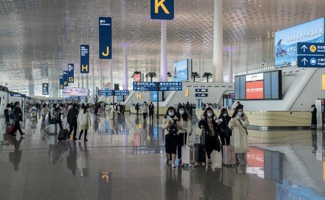 WHO team probing virus origin arrives in China Photo