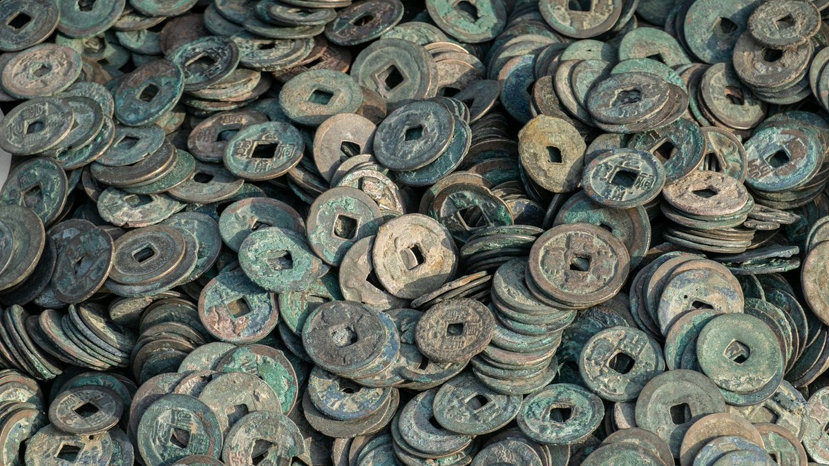 Villagers unearth nearly 20,000 ancient coins in central China
