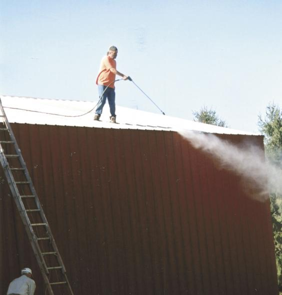 When painting metal roofs, professional painter Paul Williams, New Providence, Iowa, uses a high-pressure sprayer to remove rust before painting. #ThrowbackThursdays #painter #paint #metalroofs #highpressuresprayer #rust
