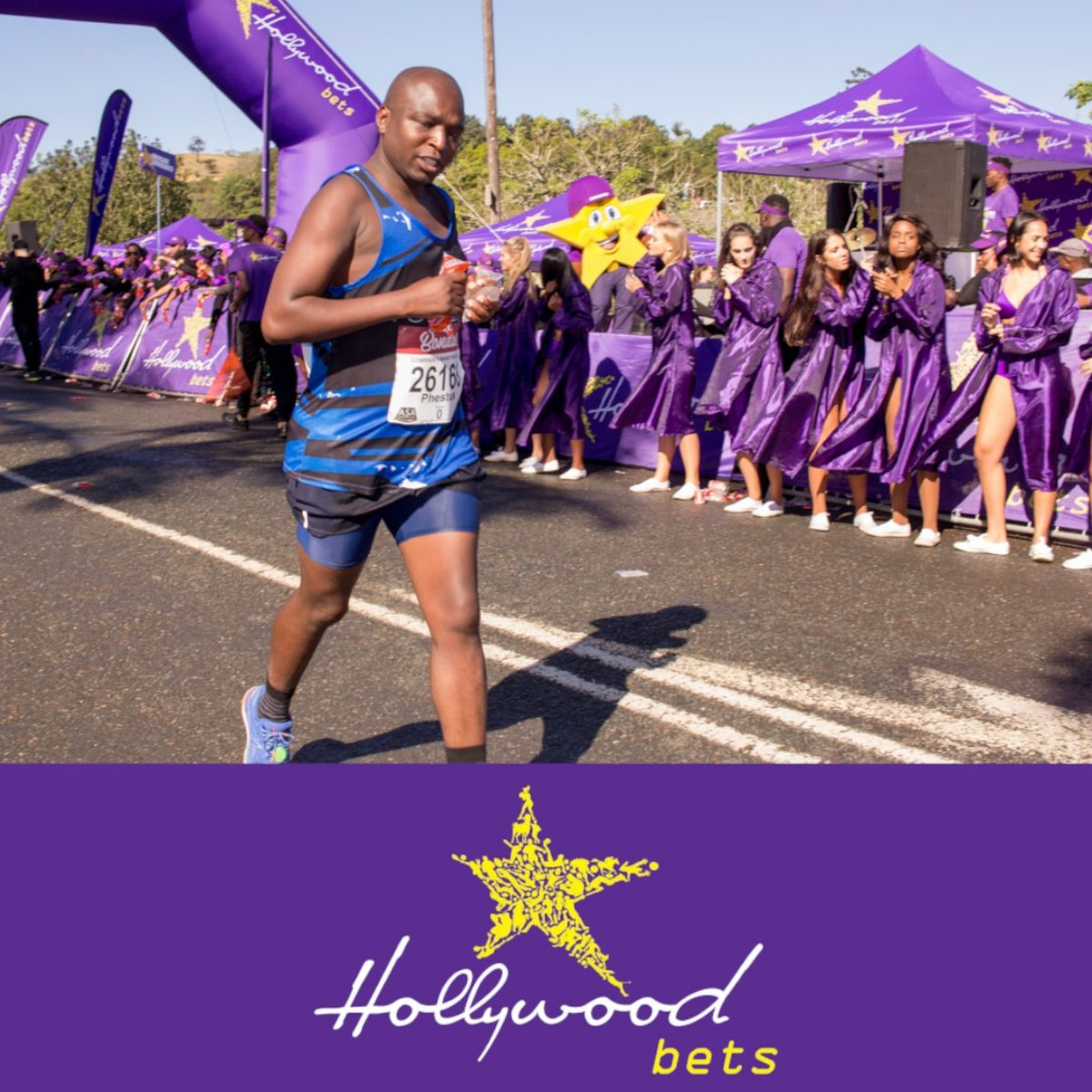 Purple! Purple! Purple! 🟣🟣🟣  The @ComradesRace @Hollywoodbets refreshment station is always lively! 💃🏾💃🏾💃🏾💜💜💜  @Hollywoodbets is an Official Sports Betting Partner to the @ComradesRace   #HollywoodBetsComrades #ComradesSponsor https://t.co/tPt6QbUIgW