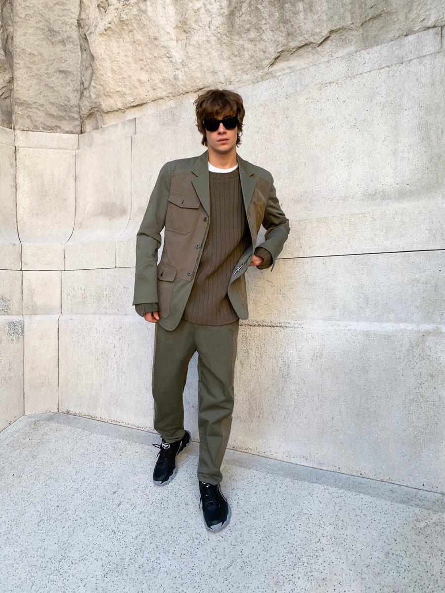 In Milan, Lorenzo Zurzolo was photographed by German Larkin in an olive green Valentino Mens look, including a multi-pocket work jacket.