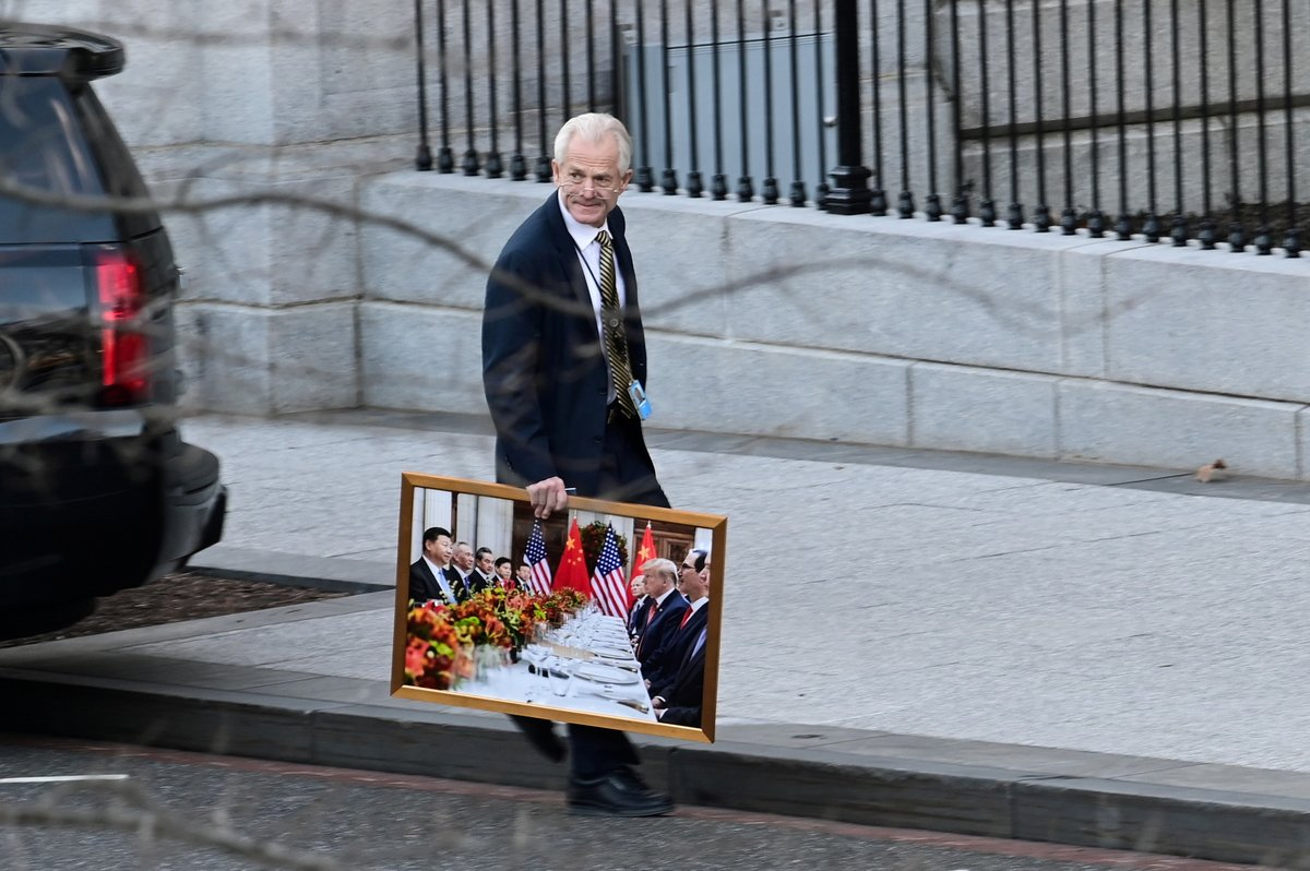 'White House advisor Peter Navarro leaves the West Wing of the White House with a photograph of U.S. President Donald Trump and Chinese President Xi Jinping, in Washington, U.S., January 13, 2021.'  📷 by @erinscottphoto