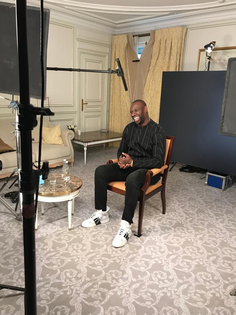 """To an event to promote Netflix's """"Lupin"""" at Le Meurice in Paris, Omar Sy wore a VLTN Times sweater and Valentino Garavani VL7N Sneakers."""