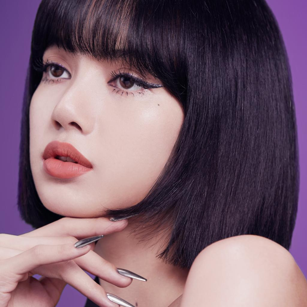 """My beauty style on stage is GLAM! Sparkles make me feel happy and pretty! But for every day, I focus on more neutral colours."" Swipe on Lisa's go-to hue, Powder Kiss Lipstick in Mull It Over, for a neutral pop of moisture-matte colour. #MACLovesLisa #MACPowderKiss"