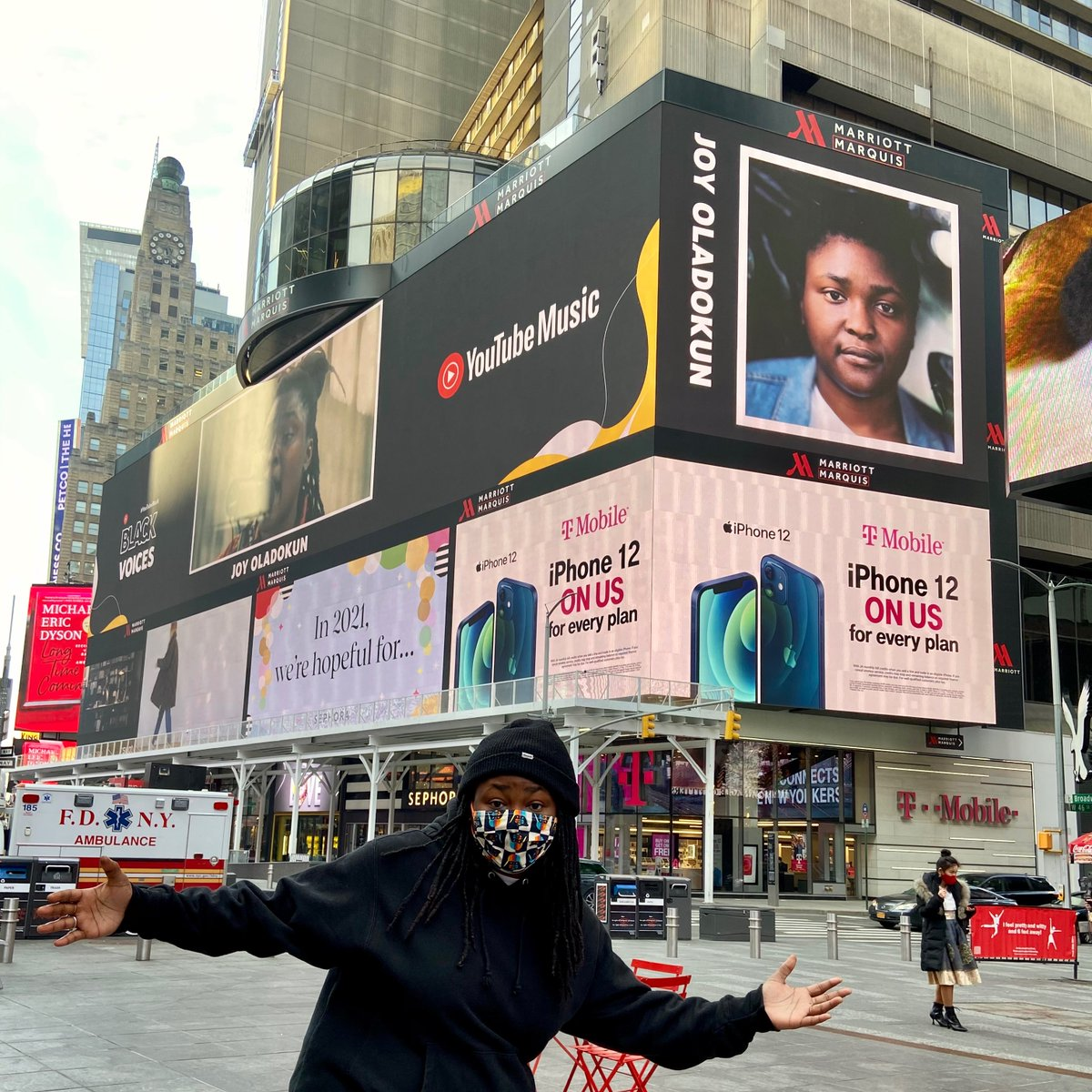 I actually don't have words for what it feels like to see my face in Times Square. thank you @youtubemusic for making this dream come true.