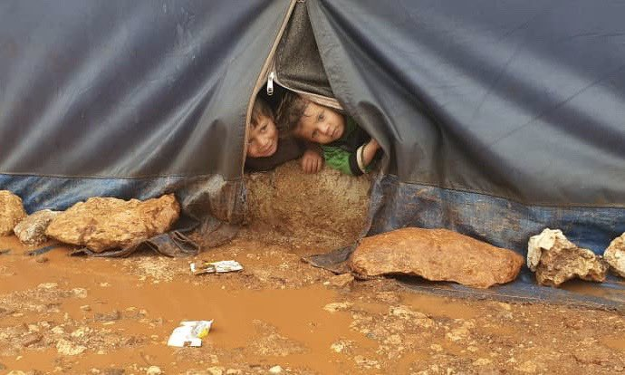 """This is """"lockdown"""" for millions of displaced people in #Syria. Stuck in a tent in the rain in the middle of winter  These children have known nothing but war. They've never lived in anything but a tent  (Picture taken in Idlib this afternoon)"""