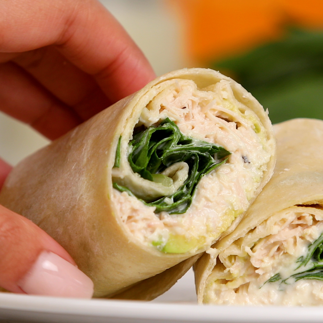 Spinach and Food Club Classic Caesar Dressing make these Chicken Caesar Wraps a healthy must for an on-the-go lunch. 🌯 🍽 Get the recipe ➡ bit.ly/35DqHmM #BrookshireBrothers #ChickenCaesarWraps #Instayum #recipe #cookathome #healthyeats