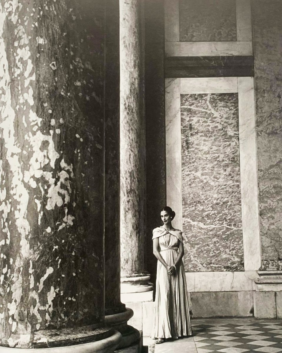 Jeanne Klein (probably), wearing Marcelle #Chaumont's pleated soft as chiffon gold lamé dress exuding Grecian simplicity, photographed by #Clifford #Coffin at the Grand Trianon, Chateau de #Versailles, France, 1948. #VintageFashion