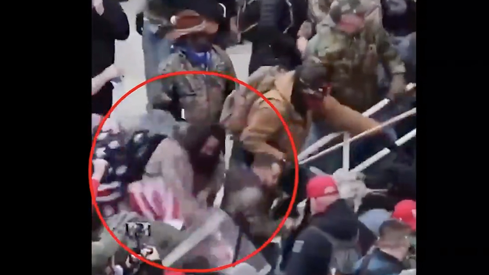 Police arrest man they say beat officer with American flag during Capitol riot