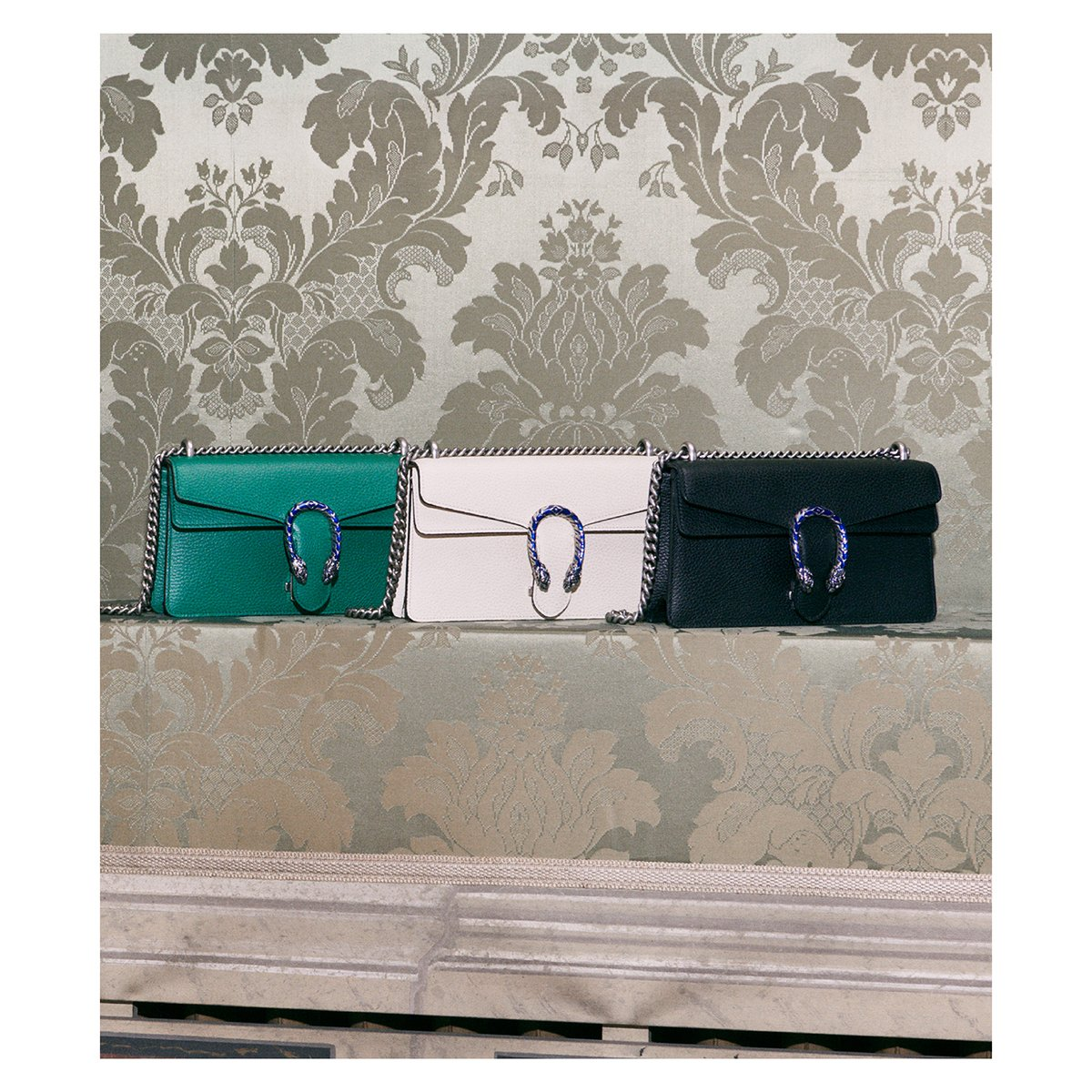Defined by its tiger head closure, the #GucciDionysus shoulder bags take on a new vibrancy in white and black leather as well as a vivid shade of green with electric blue enamel on the closure. Discover more . #GucciEpilogue #AlessandroMichele