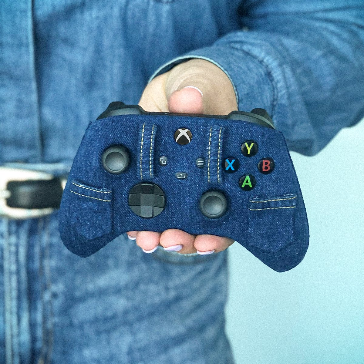 "The ""Canadian tuxedo"" is now a 3-piece suit. 👖🎮🇨🇦 This Canadian Tuxedo controller is one-of-a-kind, but let us know what your dream Canadian-themed controller would be. We might just make it..."
