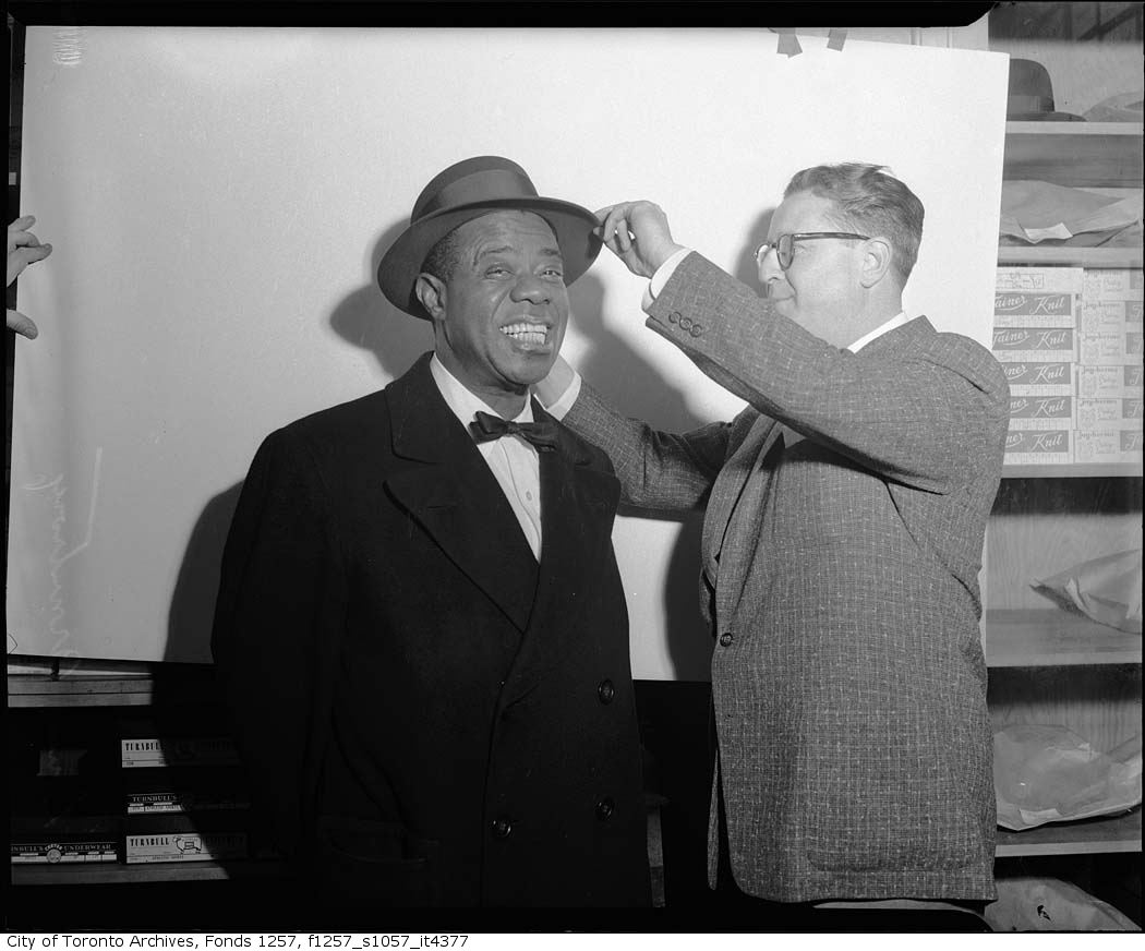 It's #NationalHatDay Toronto! To celebrate, here's a shot of the one and only Louis Armstrong being fitted with a lovely chapeau by hatter Sam Taft. Photo: Alexandra Studio. For more check out our @Flickr album devoted to hats and those who wear them!