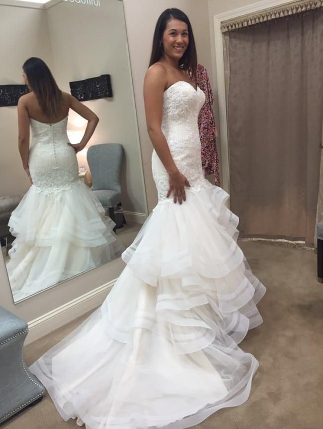 """This fit-and-flare wedding gown has a #pretty lace bodice. the beading is delicate and not overdone. The skirt of this #bridal #gown is unique in that it has a wider trim on the hem. Have custom #wedding #dresses & replicas made to order for less."""