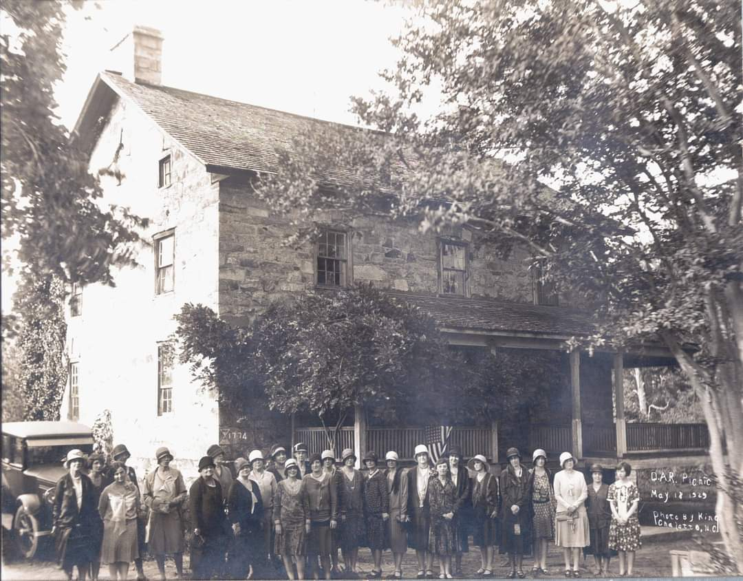 It's #NationalHatDay & we couldn't resist sharing this 1929 image of the @MecklenburgDar rocking some pretty awesome hats at a picnic in front of the Rock House.  Yes, that is the same 1774 Rock House that's at the Museum now! The porch was removed during the restoration.