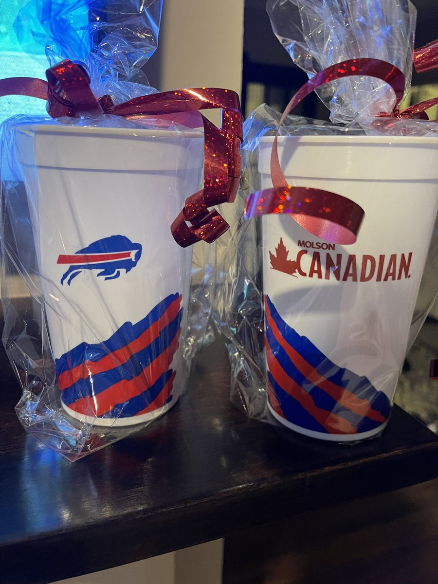 Tweet 2 of 2. The items on the steps, 2 Bills cups full of red, white, and blue Hershey kisses. Bills fever is alive and well. Thank you who ever you are! #BillsMafia