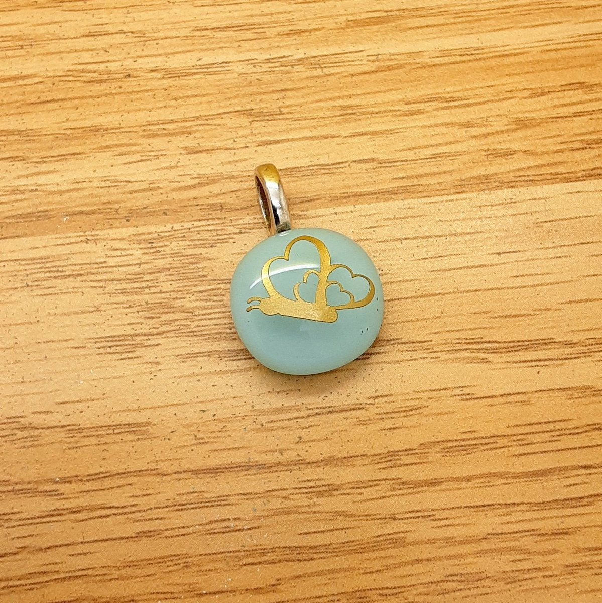 A lovely new petite #handmade glass pendant  with gold heart butterfly design.