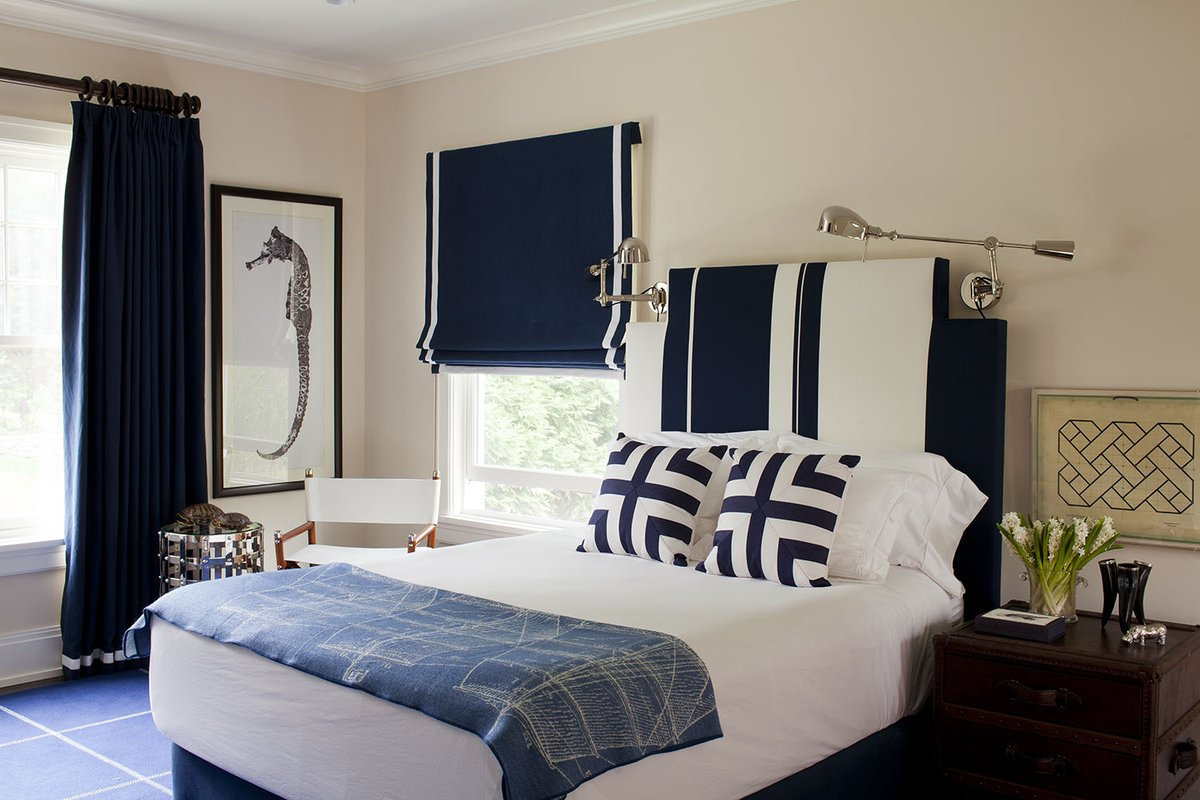 Double duty: this child's #bedroom, at the family weekend home in #LongIsland, has to serve as the occasional guest bedroom. The #design — strong in blue and white #graphic #patterns, with #nickel accents — fits the bill as #masculine but totally #beach appropriate. 💙🌊🐟