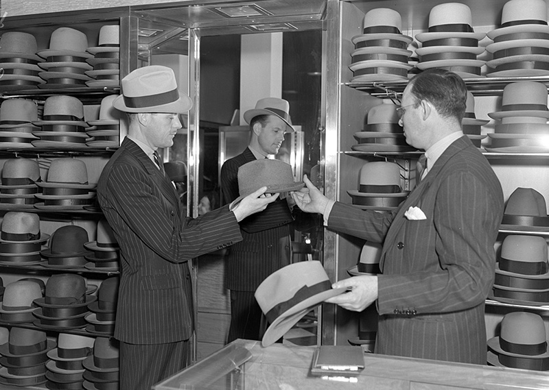 Hats on hats on hats. 🎩  A shopper peruses a selection of fine fits at Pauson's in San Francisco in 1939. #NationalHatDay  Historical photos + more ⏩