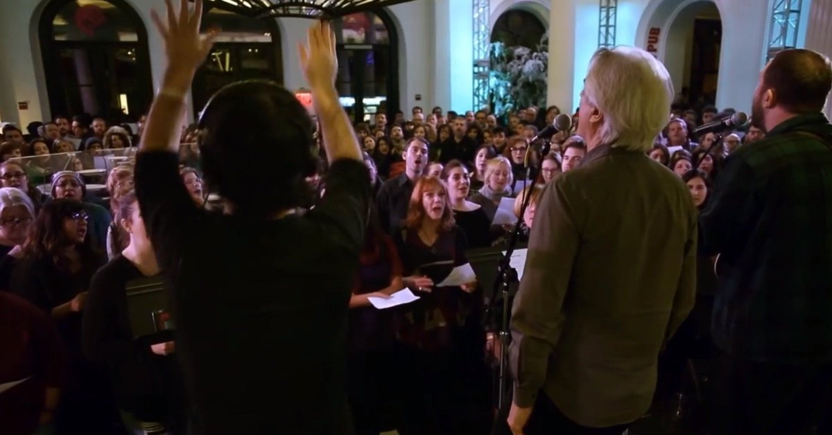 "Byteside Rewind: David Byrne leads a flash choir in an amazing rendition of Bowie's ""Heroes"" (even the idea of gathering like this these days is lovely, let along the quality of the production). #throwback"