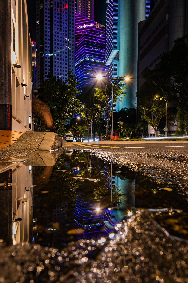 The Central Business District is typically quiet after office hours. Here's a small puddle reflection of One Raffles Place at night.  #Singapore #CitybyNight #Cityscape #exploresingaporr #visitsingapore #singaporediscovers #reflection @OneRafflesPlace @VisitSingapore