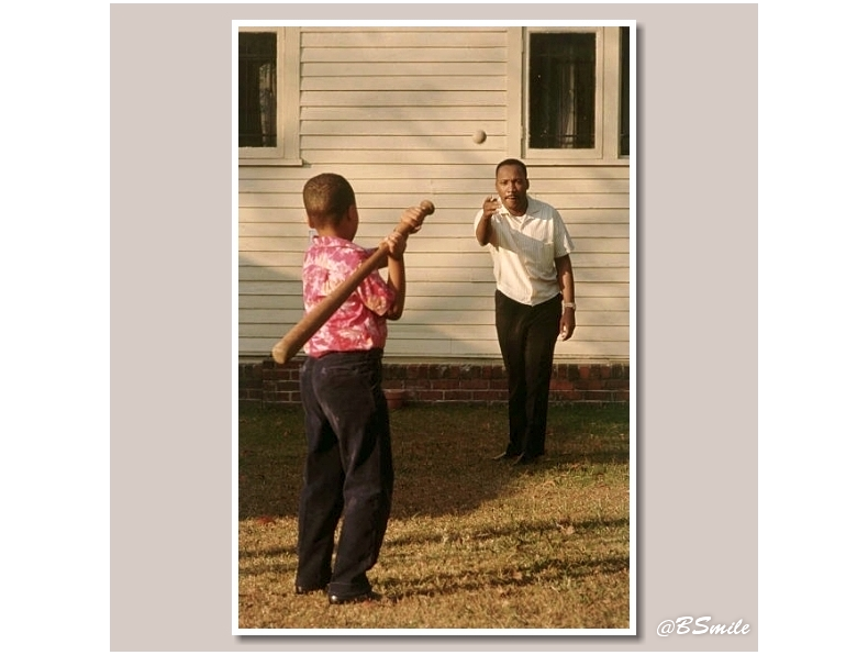 Martin Luther King Jr. tosses a baseball to his son Marty in the backyard of their home in Atlanta (1964) #MLKDAY