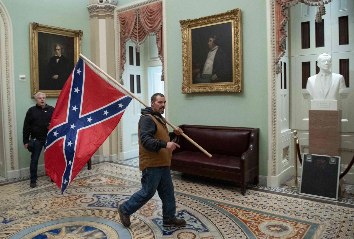 To remain consistent with history, Confederate flag-holding Kevin Seefried has surrendered to authorities in Delaware. https://t.co/U8SOAuI518