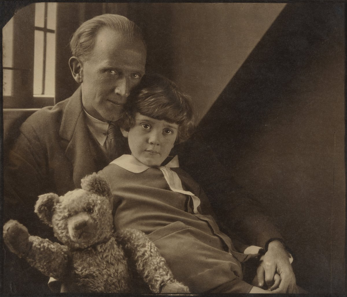 Happy #winnethepoohday! Writer A.A Milne was born #onthisday in 1882. In this intimate portrait, photographed in the year that the children's classic was first published, Milne is captured with his son Christopher Robin and the original Pooh Bear.   📷 by Howard Coster, 1926