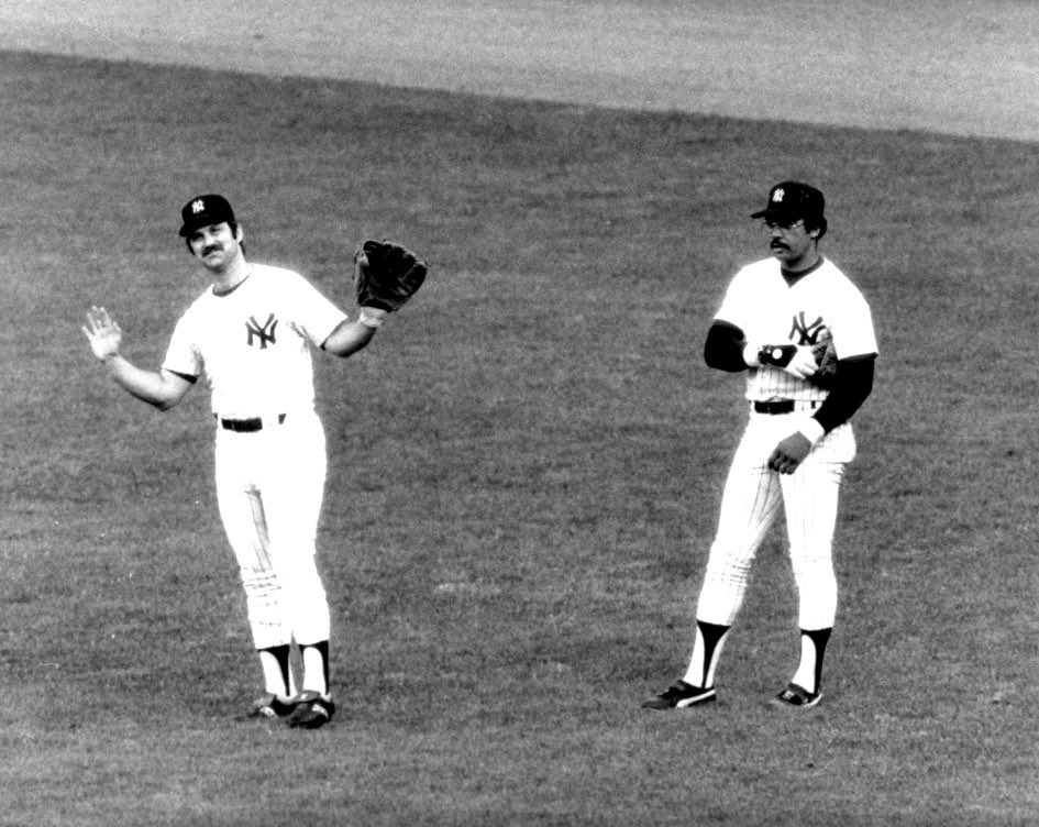 Thurman Munson with a fielders glove beside @mroctober in the outfield. Wondering what is going through Reggie' mind in this one. Haha.