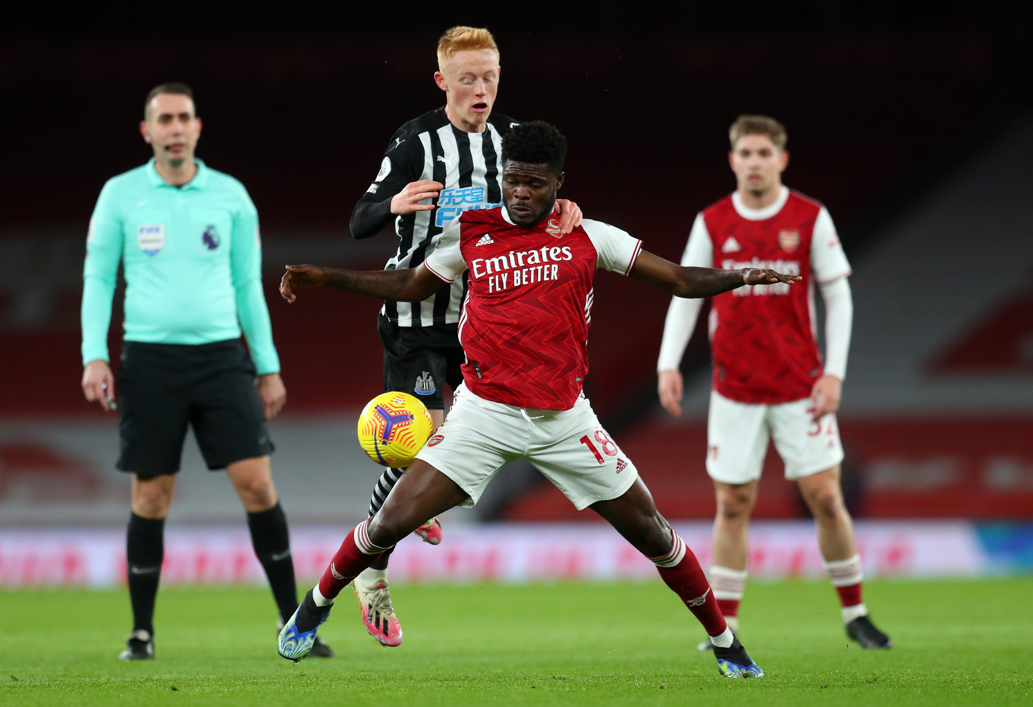 Thomas Partey stands firm to shield the ball away from Matty Longstaff