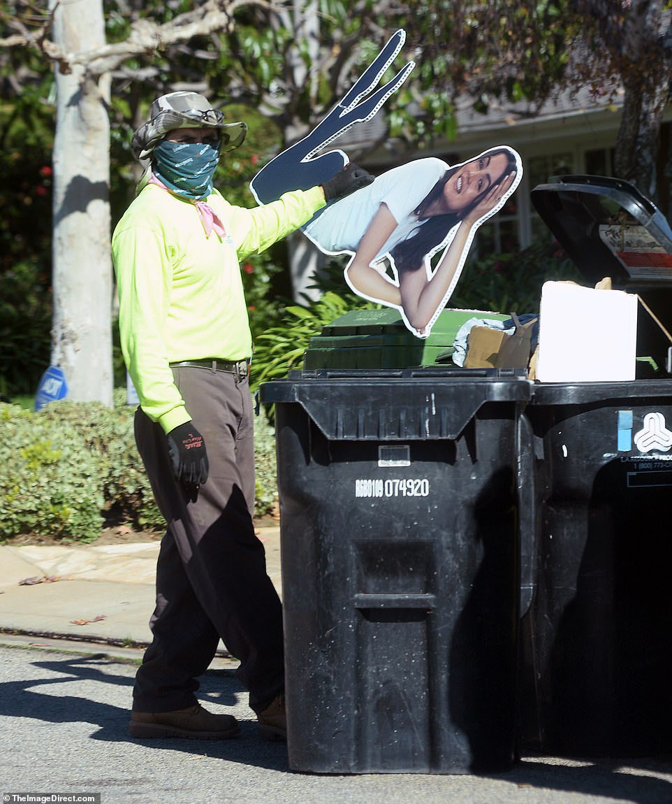 A life-sized cardboard cutout of Ana de Armas from inside Ben Affleck's residence was seen being thrown out into a trash can. (January 18, 2021)