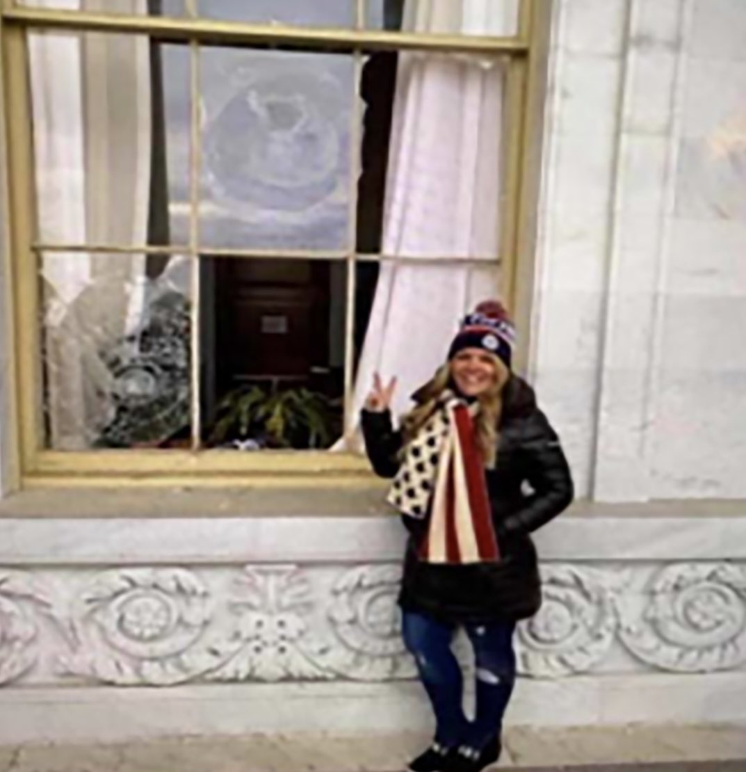 """""""I didn't realize there was actually violence,"""" said a woman who POSED FOR A PHOTO NEXT TO A BROKEN WINDOW."""