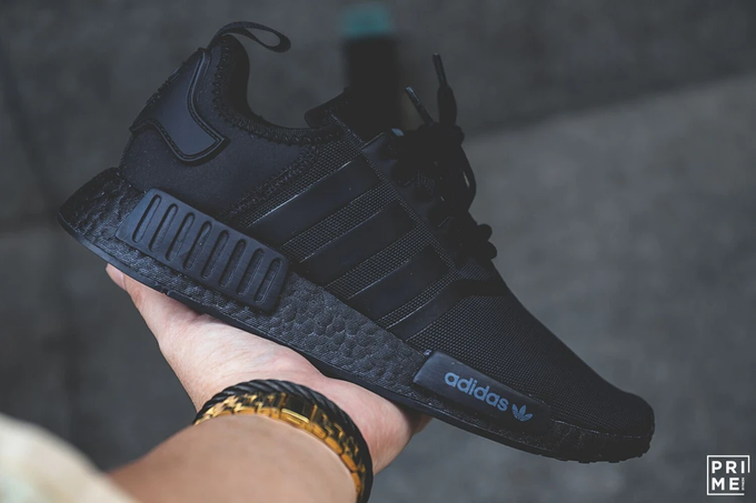 """#ad OVER 35% OFF 💥 FREE SHIPPING  Grab the adidas NMD R1 """"Triple Black"""" for $87.99 (Retail $140)   Sizes available here ->"""