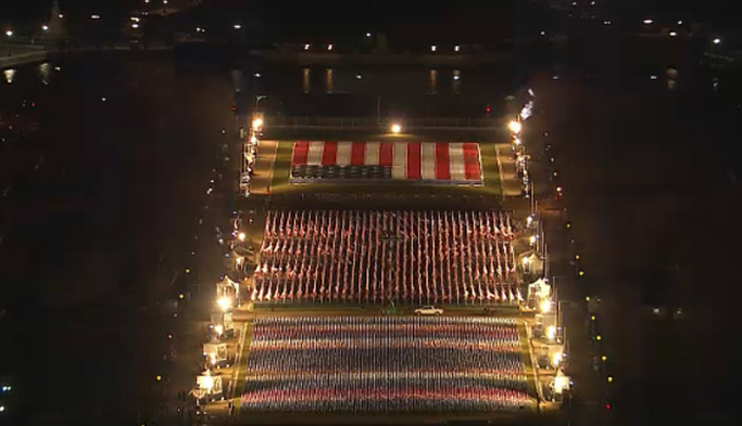 Photos: Nearly 200,000 U.S. flags on display at the National Mall were illuminated tonight with pillars of light.