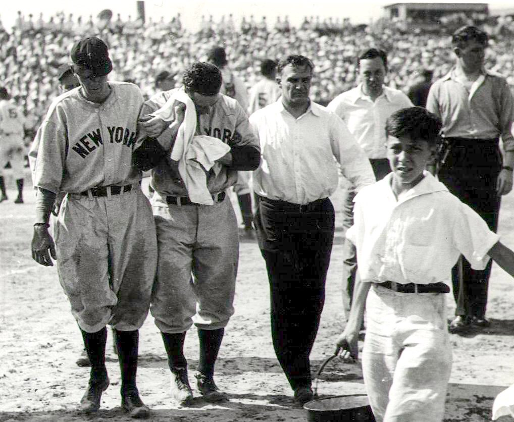 Lou Gehrig gets helped off the field after getting hit in the head. So much going on this picture. Find it awesome. * disclaimer - no I don't think it's awesome that Lou got hit in the head