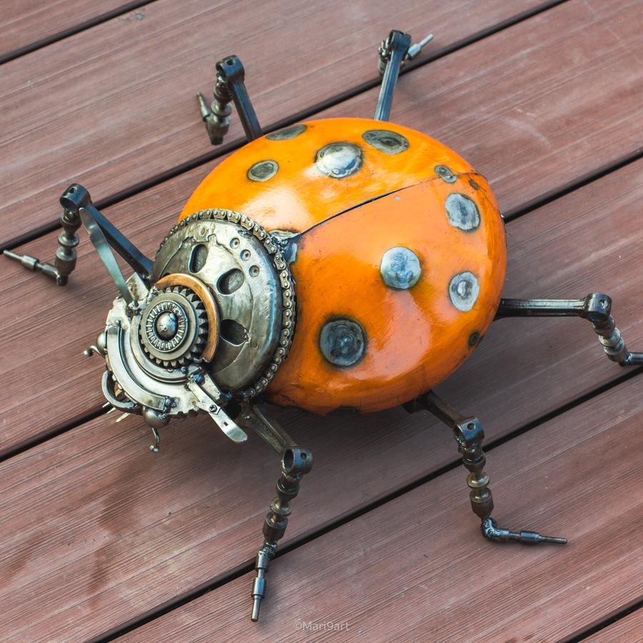 Ladybird scrap metal sculpture. his orange wing made from gas container.  #ladybird #bug #sculpture #metalsculpture #metalart #animalsculpture