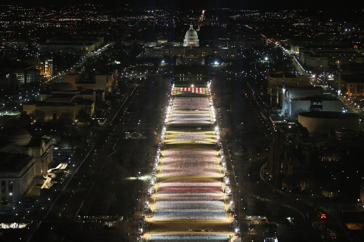 Stunning pictures of the National Mall set up for inauguration with flags representing Americans who can't attend in person (via Getty)