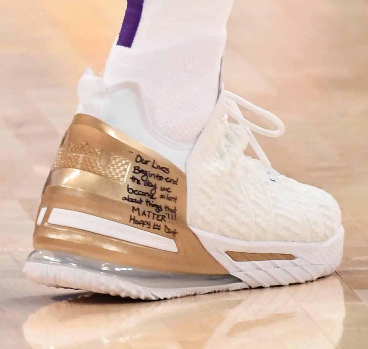 "Clean white & gold for LeBron on #MLKDay   🖊 ""Our lives begin to end the day we become silent about things that MATTER!!!  Happy 👑 Day"""
