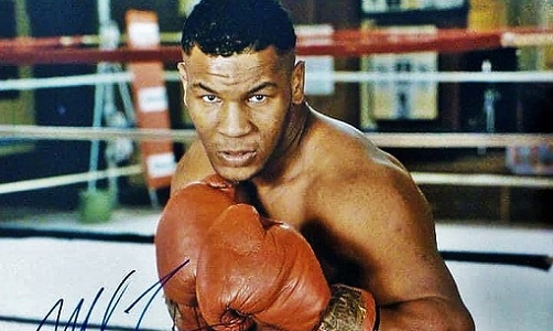 """Autographed photo of a young Mike Tyson, protégé of Cus D'Amato. From March 1985 to Nov. '86, a ruthless """"Kid Dynamite"""" laid waste to the big man division, scoring 28 wins, 26 by KO, & seizing his 1st world title at the age of 20. #Heavyweight #History #Boxing #MikeTyson #Legend"""