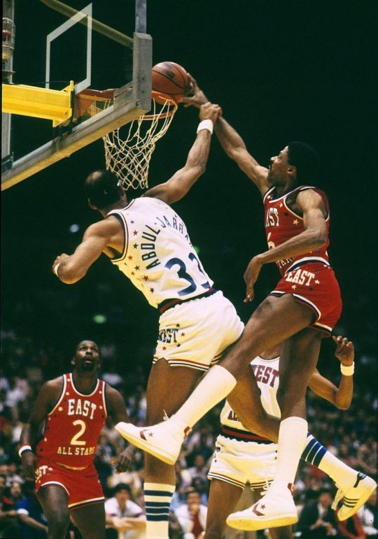 """""""Dr. J"""" Julius Erving goes in to throw down a dunk and Kareem Abdul - Jabber reaches out to try to stop him during an NBA All Star Game. #JuliusErving #DrJ #basketball #KareemAbdulJabbar #AllStarGame"""