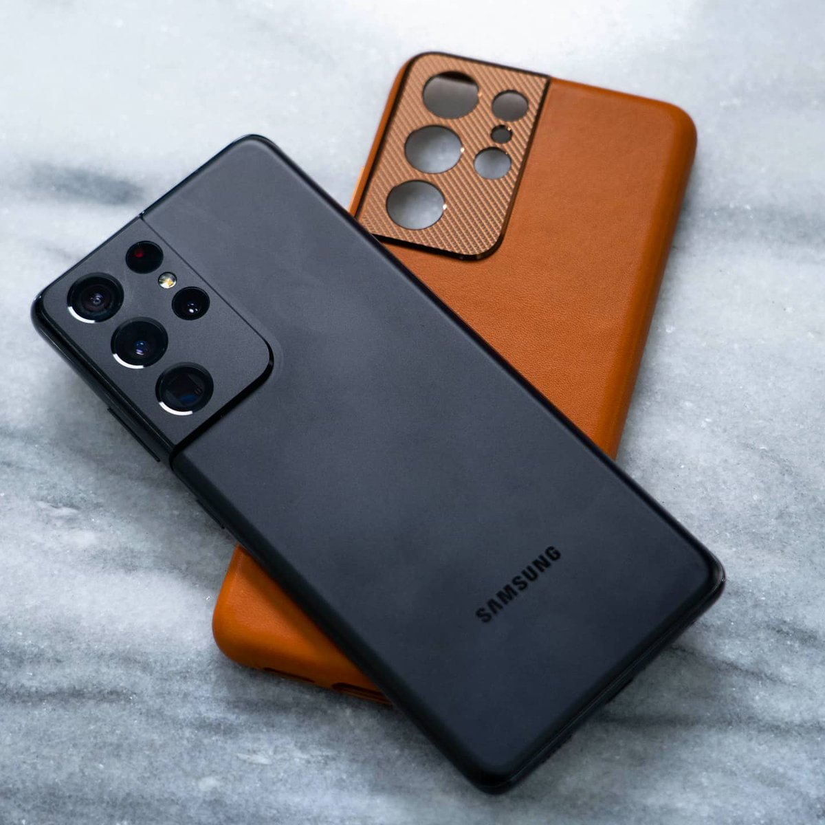 Replying to @booredatwork: The official brown leather case for the #GalaxyS21Ultra is 🔥. What accessories are you using?