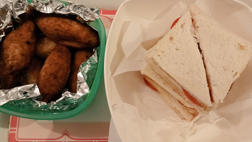 #NotSoDesiKhana: Meat is rare here given the #BirdFlu scare so tonight's late dinner is also a favourite breakfast: Tomato and Cucumber Sandwiches with Breaded Potato and Peas Rolls.