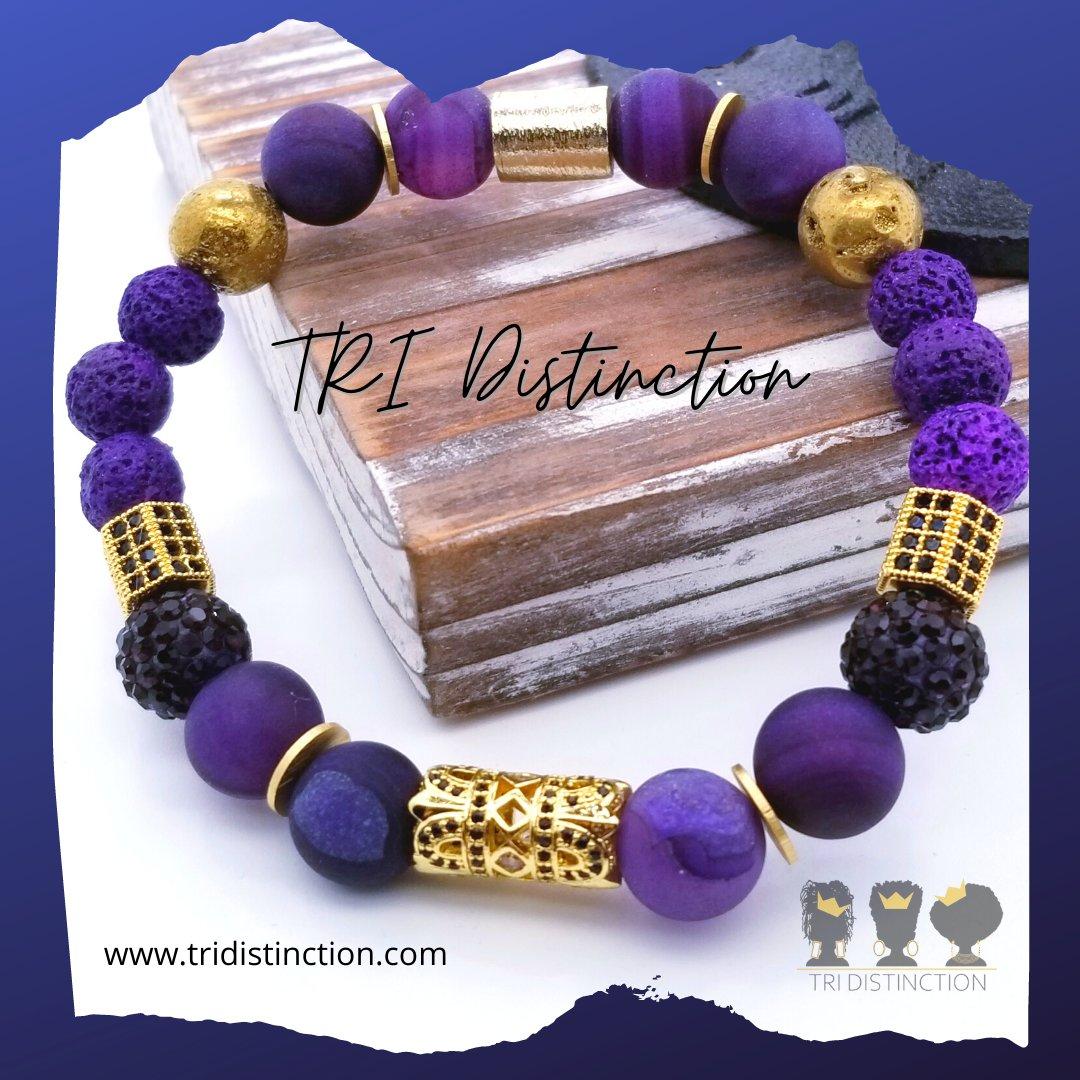 Purple & Gold bracelet💜💛! 🛍️SHOP NOW! ➡️  #TRIDistinction #handmadejewelry #BlackJewelryDesigners #WomenBracelet #BlackBusinessWomen #OmegaPsiPhiBracelet #braceletstacks #mensjewelry #mensaccessories #menslook #BlackBusiness #wristgame #braceletoftheday