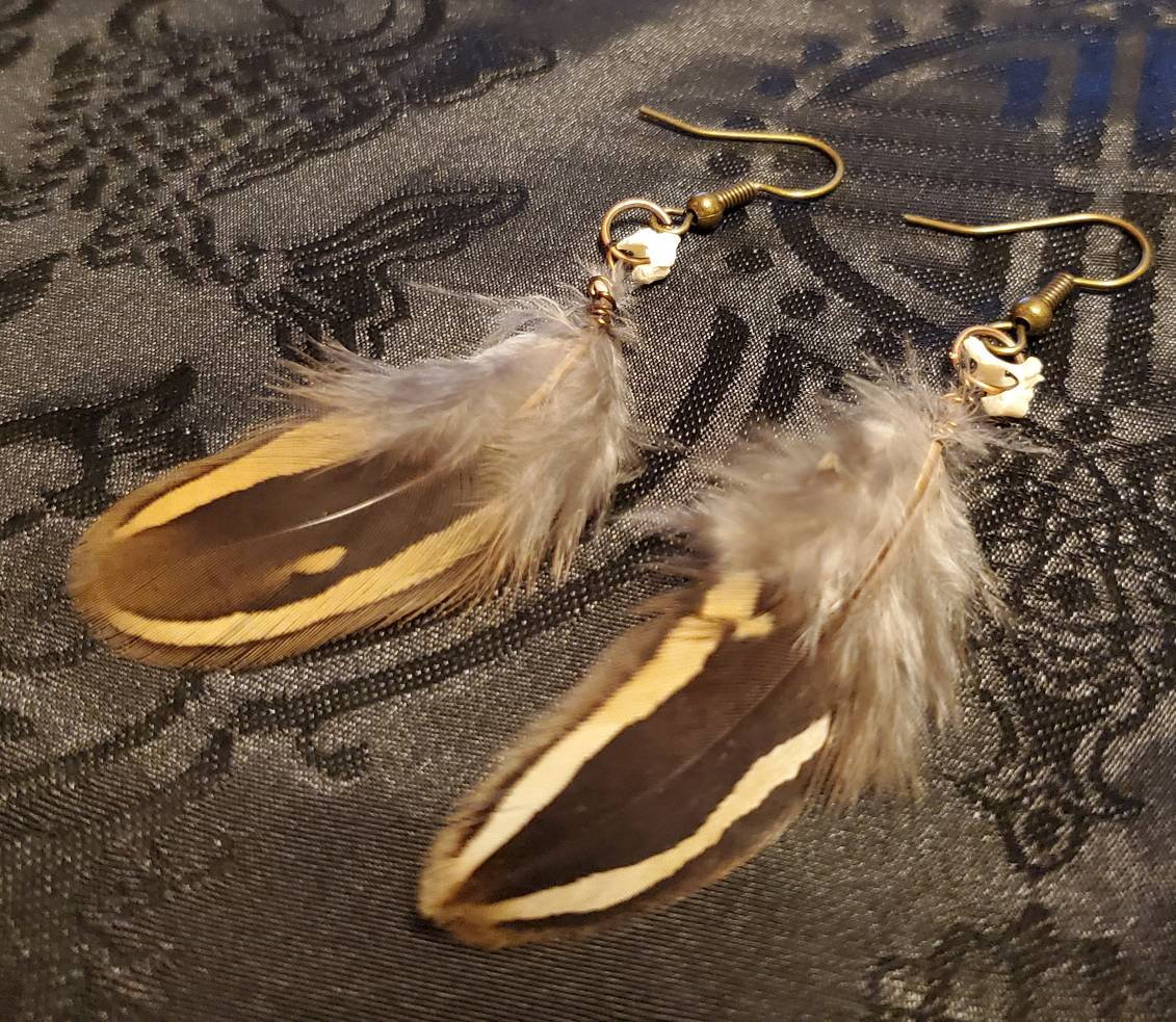 Excited to share the latest addition to my #etsy shop: Rat Vertebra and Brown Partridge Feather Earrings!  As always all animal products are ethically sourced.    #necromancy #rat #steampunk #animalbone #nature #vertebra #druid #modern #witch