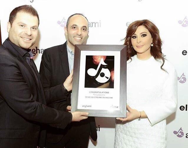 The Queen is back ! @elissakh with @anghami 🔆 @elie_h  @EddyMaroun منصّة موسيقيّة لبنانية 🇱🇧  • أول فنانة بتحققّ 100 مليون مستمع منذ تأسيس انغامي ٢٠١٢!  •الأكثر متابعة بأكتر من 16 مليون!  •أكتر من نصف مليار مستمع عَ انغامي!   *مع العلم انو أغلب ارشيفها إنحذف من أنغامي ❕