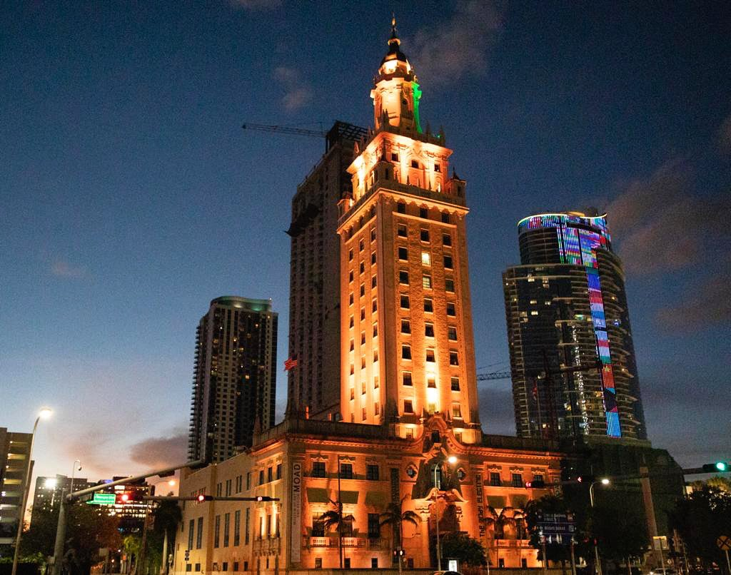 Tonight, we illuminate our #Miami Freedom Tower #amber for a national moment of silence in honor and remembrance of the lives lost to #COVID19.  #BeMDC #COVIDMemorial